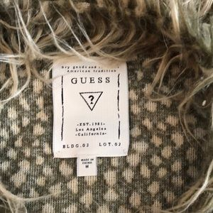 Guess fur vest. Hidden snaps to close